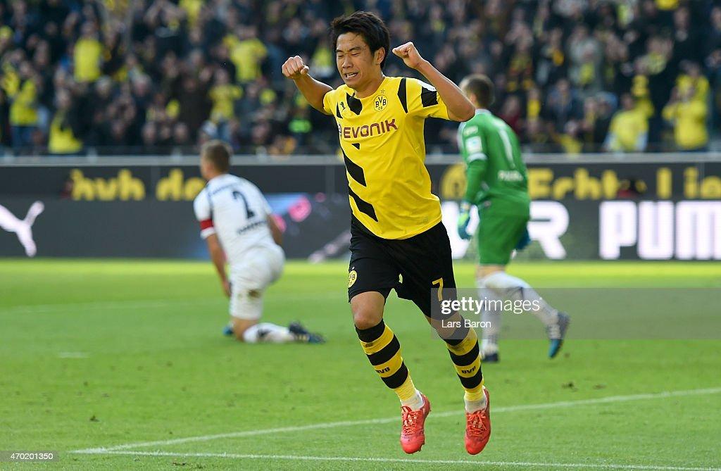 Shinji Kagawa of Borussia Dortmund celebrates after scoring his teams third goal during the Bundesliga match between Borussia Dortmund and SC...