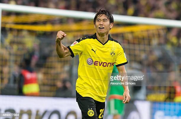 Shinji Kagawa of Borussia Dortmund celebrates after scoring his team's 2nd goal during the Bundesliga match between Bayer 04 Leverkusen v Borussia...