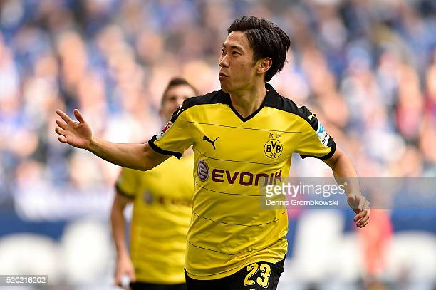 Shinji Kagawa of Borussia Dortmund celebrates after scoring the opening goal during the Bundesliga match between FC Schalke 04 and Borussia Dortmund...