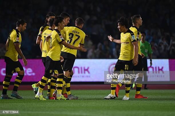 Shinji Kagawa of Borussia Dortmund celebrates his opener with Mitsuru Maruoka of Borussia Dortmund during the preseason friendly match between...