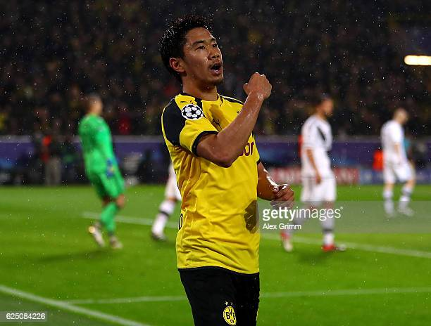 Shinji Kagawa of Borussia Dortmund celebrates scoring his teams first goal during the UEFA Champions League Group F match between Borussia Dortmund...
