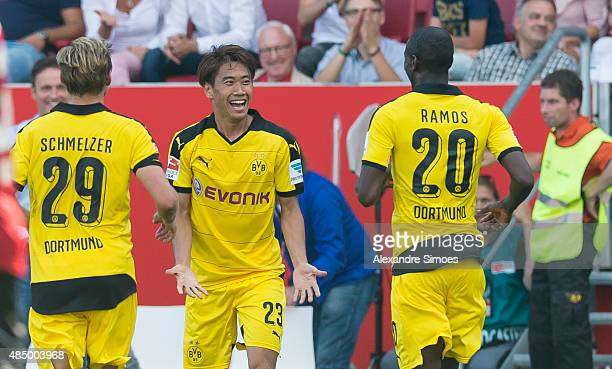 Shinji Kagawa of Borussia Dortmund celebrates scoring the goal to the 03 together with his team mates during the Bundesliga match between FC...