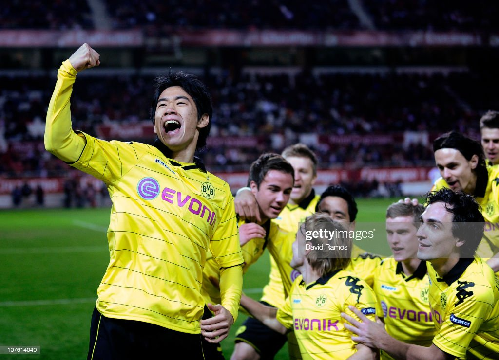 Shinji Kagawa of Borussia Dortmund celebrates with his team mates after scoring the opening goal during the UEFA Europa League group J match between...