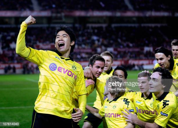Shinji Kagawa of Borussia Dortmund celebrates with his team mates after scoring the opening goal during the UEFA Europa League group J match between...