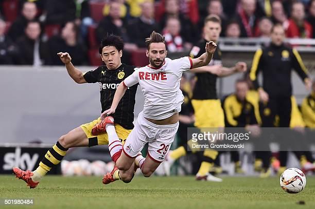 Shinji Kagawa of Borussia Dortmund challenges Dusan Svento of 1 FC Koeln during the Bundesliga match between 1 FC Koeln and Borussia Dortmund at...