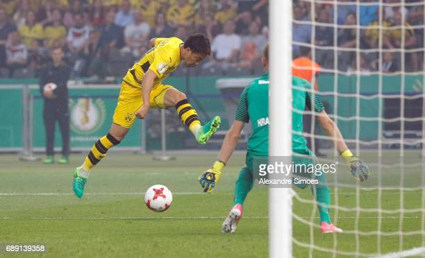 Shinji Kagawa of Borussia Dortmund challenges goal keeper Lukas Hradecky of Eintracht Frankfurt during the DFB Cup Final match between Eintracht...