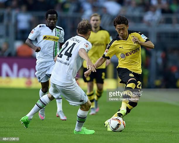 Shinji Kagawa of Borussia Dortmund controls the ball during the Bundesliga match between Borussia Dortmund and Borussia Moenchengladbach at Signal...