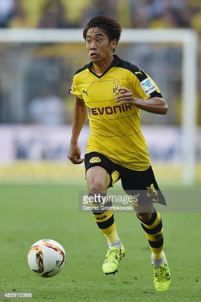 Shinji Kagawa of Borussia Dortmund controls the ball during the Bundesliga match between Borussia Dortmund and Hertha BSC at Signal Iduna Park on...
