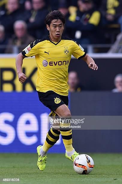 Shinji Kagawa of Borussia Dortmund controls the ball during the Bundesliga match between Borussia Dortmund and Bayer Leverkusen at Signal Iduna Park...