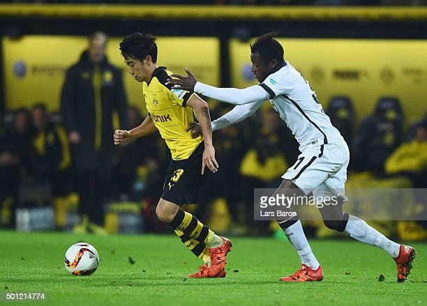 Shinji Kagawa of Borussia Dortmund evades David Kinsombi of Eintracht Frankfurt during the Bundesliga match between Borussia Dortmund and Eintracht...