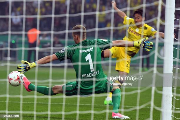 Shinji Kagawa of Borussia Dortmund in action against Lukas Hradecky of Eintracht Frankfurt during the DFB Cup Final 2017 soccer match between...