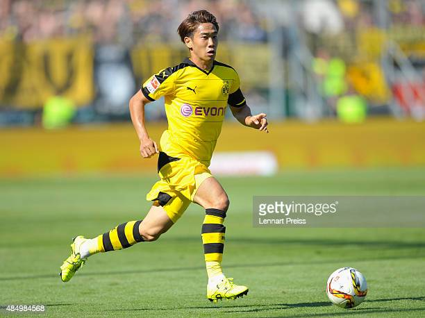 Shinji Kagawa of Borussia Dortmund in action during the Bundesliga match between FC Ingolstadt and Borussia Dortmund at Audi Sportpark on August 23...