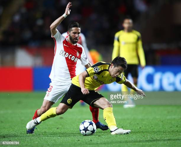 Shinji Kagawa of Borussia Dortmund is challenged by Joao Moutinho of Monaco during the UEFA Champions League Quarter Final second leg match between...