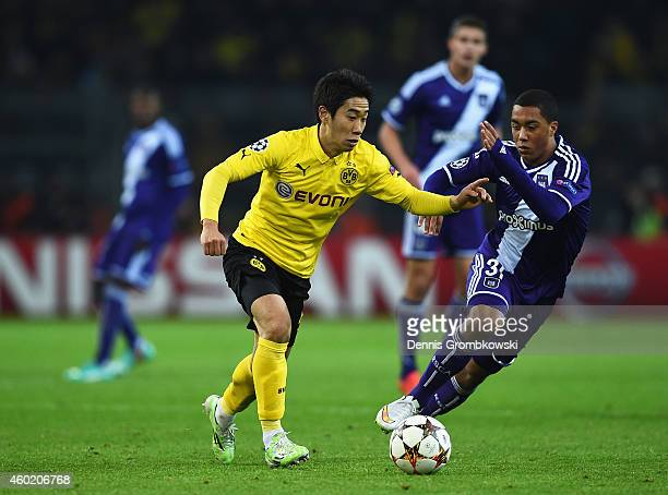Shinji Kagawa of Borussia Dortmund is closed down by Youri Tielemans of Anderlecht during the UEFA Champions League Group D match between Borussia...