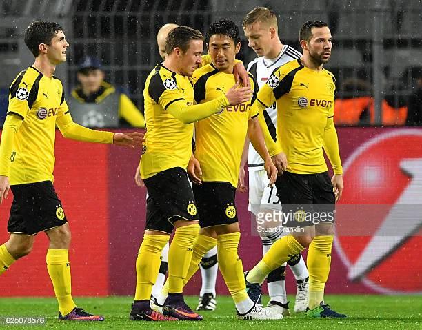 Shinji Kagawa of Borussia Dortmund is congratualted by teammates during the UEFA Champions League Group F match between Borussia Dortmund and Legia...