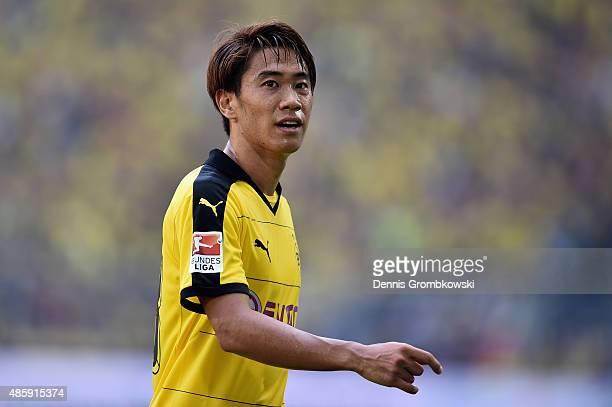 Shinji Kagawa of Borussia Dortmund looks on during the Bundesliga match between Borussia Dortmund and Hertha BSC at Signal Iduna Park on August 30...