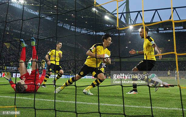 Shinji Kagawa of Borussia Dortmund picks up the ball after scoring his team's second goal during the Bundesliga match between Borussia Dortmund and...