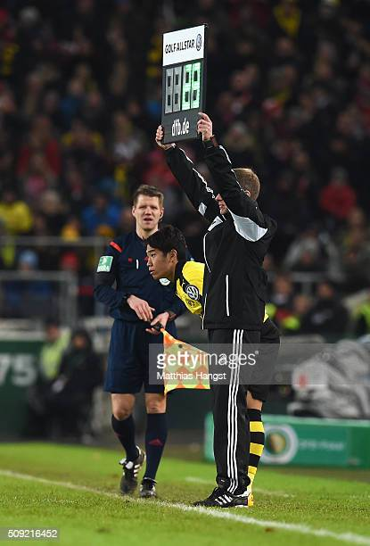 Shinji Kagawa of Borussia Dortmund prepares to come on as a substitute during the DFB Cup Quarter Final match between VfB Stuttgart and Borussia...