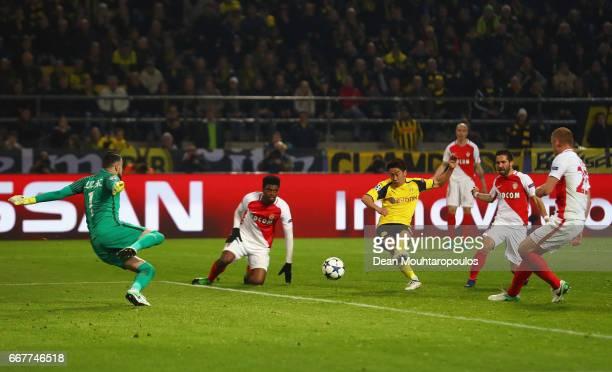 Shinji Kagawa of Borussia Dortmund scores his team's second goal of the game during the UEFA Champions League Quarter Final first leg match between...