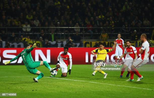 Shinji Kagawa of Borussia Dortmund scores his team's second goal of the game during the UEFA Champions League Quarter Final first leg match between...