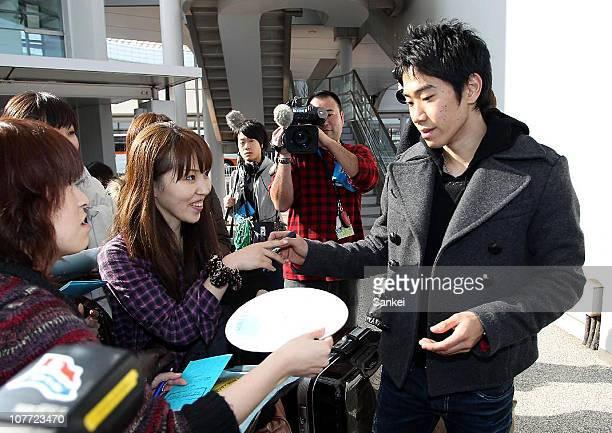 Shinji Kagawa of Borussia Dortmund signs autographs to fans upon arrival at Narita International Airport on December 21 2010 in Narita Chiba Japan