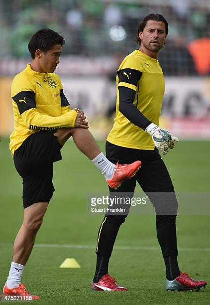Shinji Kagawa of Borussia Dortmund warms up next to Roman Weidenfeller of Borussia Dortmund prior to the DFB Cup Final match between Borussia...