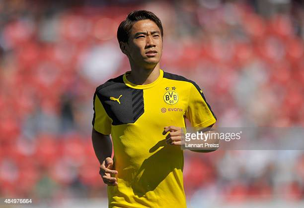 Shinji Kagawa of Borussia Dortmund warms up prior to the Bundesliga match between FC Ingolstadt and Borussia Dortmund at Audi Sportpark on August 23...
