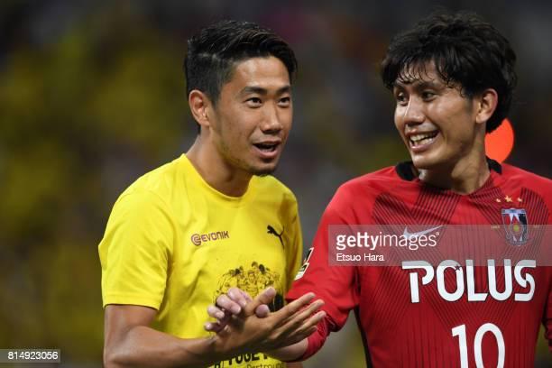 Shinji Kagawa of Burussia Dortmund and Yosuke Kashiwagi of Urawa Red Diamonds shake hands after the preseason friendly match between Urawa Red...