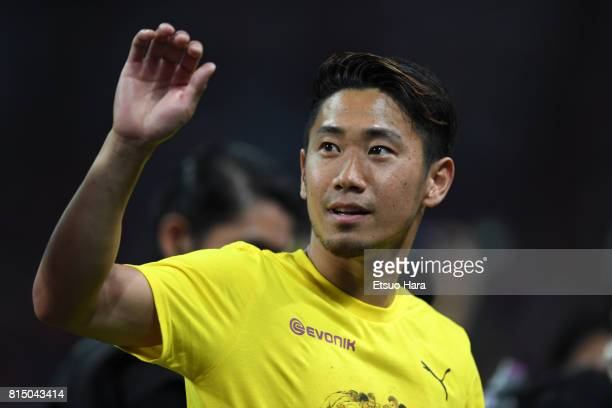 Shinji Kagawa of Burussia Dortmund applauds fans after the preseason friendly match between Urawa Red Diamonds and Borussia Dortmund at Saitama...