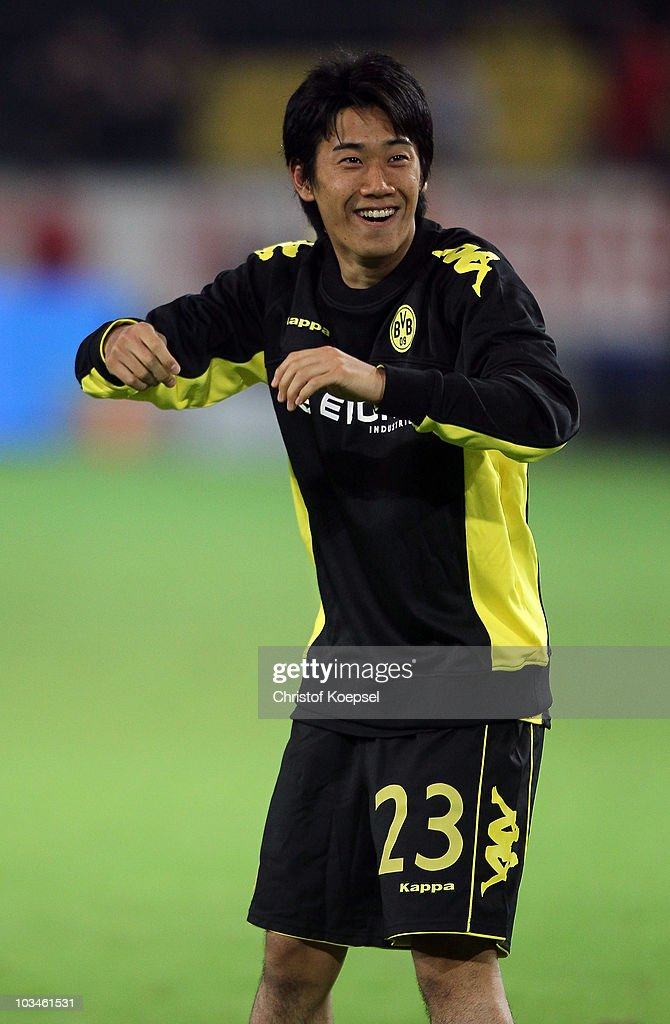 Shinji Kagawa of Dormtund celebrates after winning 40 the UEFA Europa League PlayOff match between Borussia Dortmund and Qarabag at Signal Iduna Park...