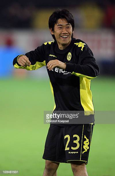 Shinji Kagawa of Dormtund celebrates after winning 40 the UEFA Europa League PlayOff match between Borussia Dortmund and Qarabag at Signal Iduna Park...