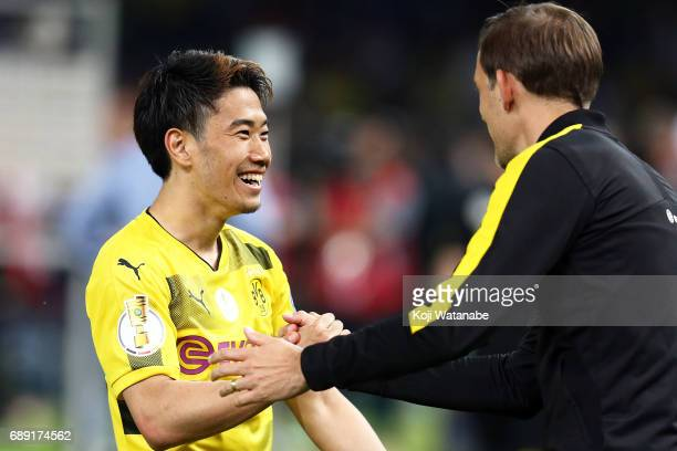 Shinji Kagawa of Dortmund and Dortmund corch Thomas Tuchel celebrate winner during at Olympiastadion on May 27 2017 in Berlin Germany