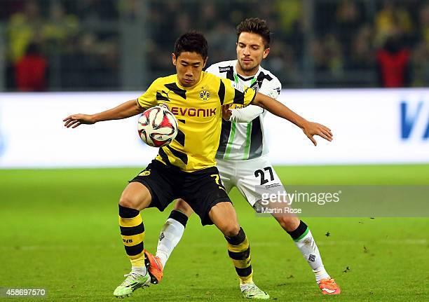 Shinji Kagawa of Dortmund and Julian Korb of Gladbach battles for the ball during the Bundesliga match between Borussia Dortmund and Borussia...