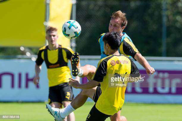 Shinji Kagawa of Dortmund and Mario Goetze of Dortmund battle for the ball during a training session as part of the training camp on July 30 2017 in...
