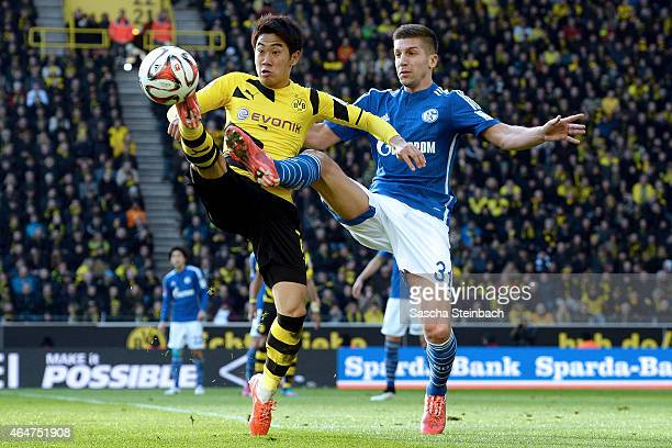Shinji Kagawa of Dortmund and Matija Nastasic of Schalke battle for the ball during the Bundesliga match between Borussia Dortmund and FC Schalke 04...