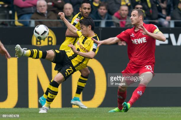 Shinji Kagawa of Dortmund and Matthias Lehmann of Colonge battle for the ball during the Bundesliga match between Borussia Dortmund and FC Koeln at...
