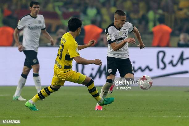 Shinji Kagawa of Dortmund and Mijat Gacinovic of Frankfurt battle for the ball during the DFB Cup final match between Eintracht Frankfurt and...