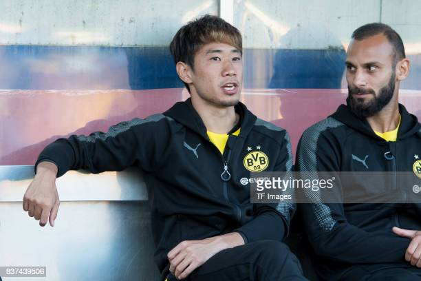 Shinji Kagawa of Dortmund and Oemer Toprak of Dortmund looks on during a friendly match between Espanyol Barcelona and Borussia Dortmund as part of...