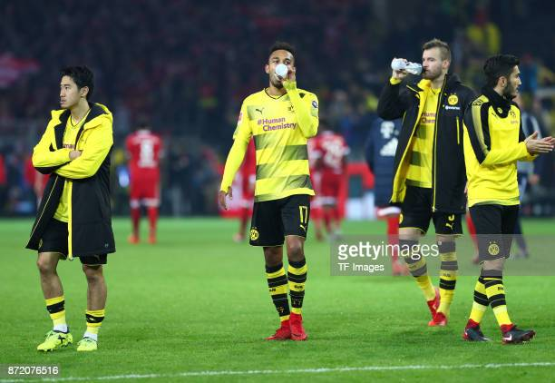 Shinji Kagawa of Dortmund and PierreEmerick Aubameyang of Dortmund Andrey Yarmolenko of Dortmund and Nuri Sahin of Dortmund looks dejected after the...
