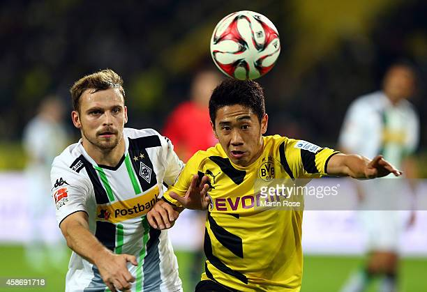 Shinji Kagawa of Dortmund and Tony Jantschke of Gladbach battles for the ball during the Bundesliga match between Borussia Dortmund and Borussia...