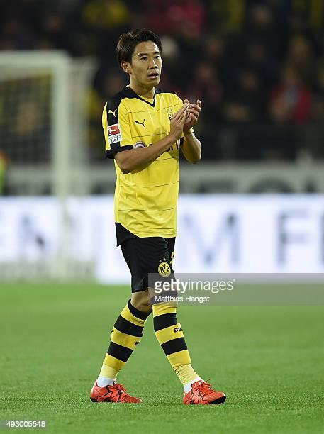 Shinji Kagawa of Dortmund applauds during the Bundesliga match between Eintracht Frankfurt and Borussia Moenchengladbach at Coface Arena on October...