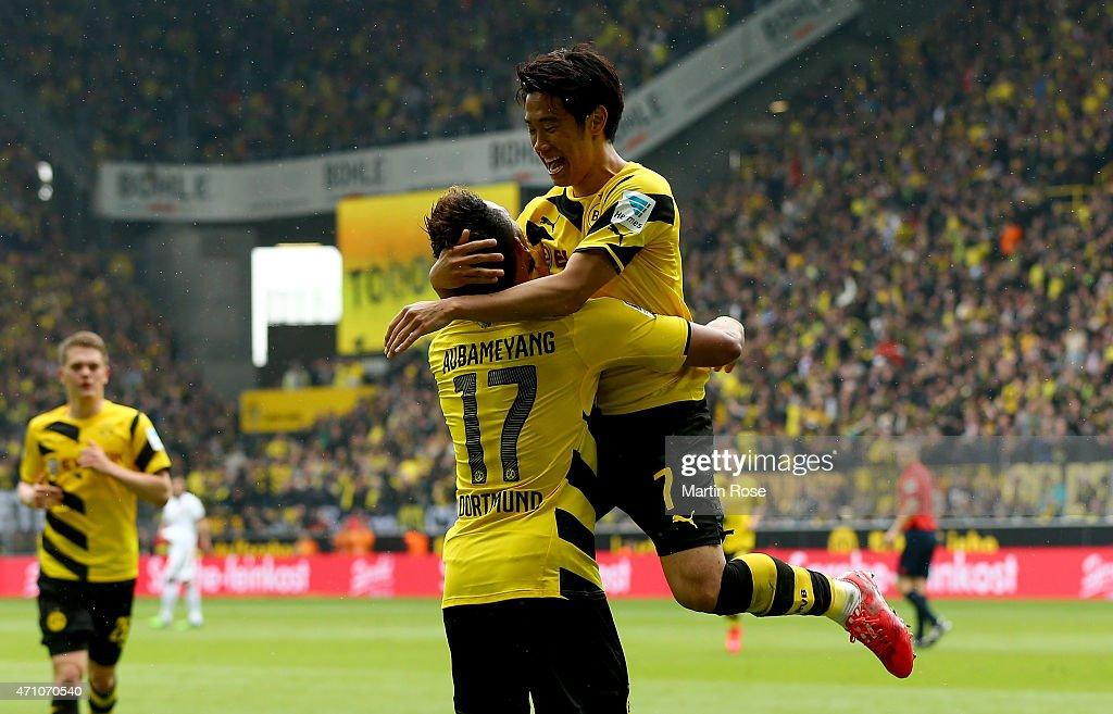 Shinji Kagawa of Dortmund celebrate with team mate Pierre Emerick Aubameyang after scoring the 2nd goal during the Bundesliga match between Borussia...