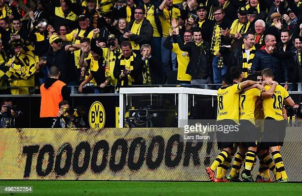 Shinji Kagawa of Dortmund celebrate with team mates after scoring his teams first goal during the Bundesliga match between Borussia Dortmund and FC...