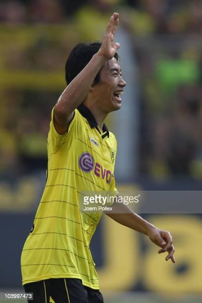 Shinji Kagawa of Dortmund celebrates after scoring his team's second goal during the Bundesliga match between Borussia Dortmund and VfL Wolfsburg at...