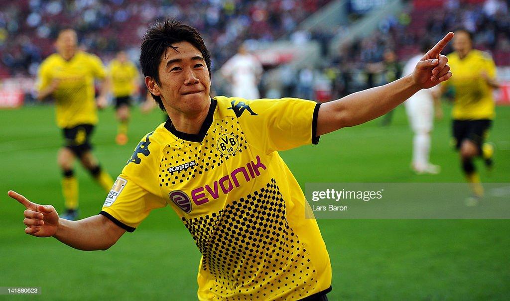 Shinji Kagawa of Dortmund celebrates after scoring his teams second goal during the Bundesliga match between 1 FC Koeln and Borussia Dortmund at...