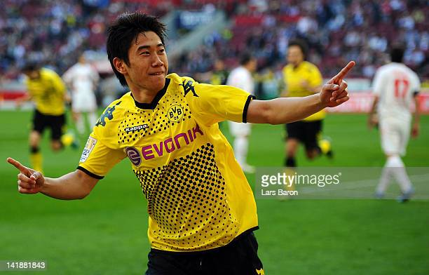 Shinji Kagawa of Dortmund celebrates after scoring his teams second goal during the Bundesliga match between 1 FC Koeln and Borussia Dortmund at...