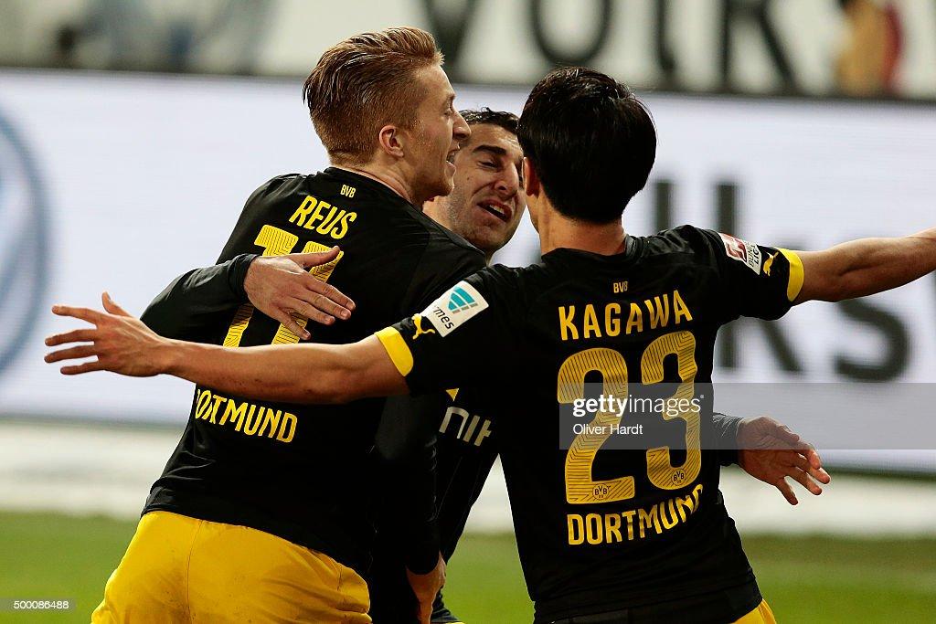 Shinji Kagawa of Dortmund celebrates after scoring their first goal with Marco Reus and Henrikh Mkhitaryan during the First Bundesliga match at...