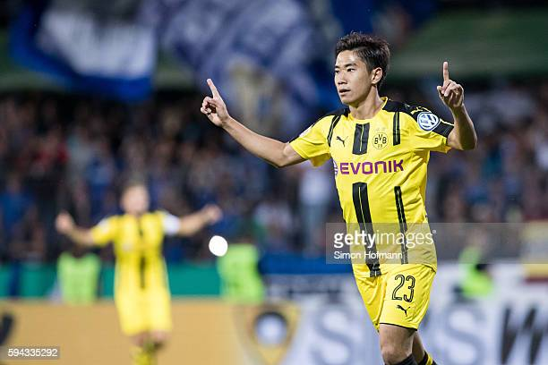 Shinji Kagawa of Dortmund celebrates his team's first goal during the DFB Cup match between Eintracht Trier and Borussia Dortmund at Moselstadion on...