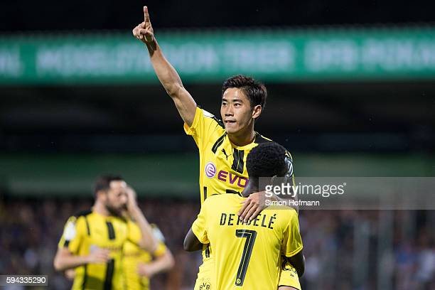 Shinji Kagawa of Dortmund celebrates his team's first goal with team mate Ousmane Dembele during the DFB Cup match between Eintracht Trier and...