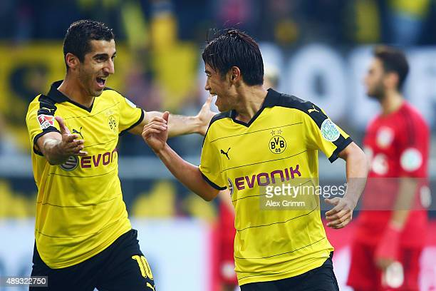 Shinji Kagawa of Dortmund celebrates his team's second goal with team mate Henrikh Mkhitaryan during the Bundesliga match between Borussia Dortmund...